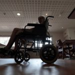 An elderly woman rests on her wheel chair during the afternoon break at a retirement home in Nice July 26, 2013. As summer temperatures continue to rise, French local authorities launched a heat wave alert for the southern part of the country during the weekend.    REUTERS/Eric Gaillard (FRANCE - Tags: SOCIETY HEALTH) - RTX1202Q